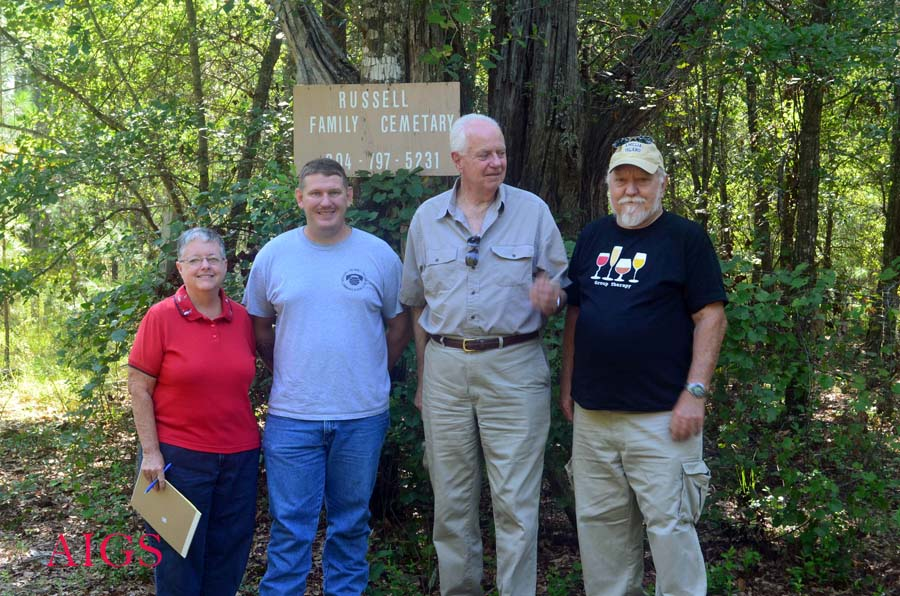 Russell Family Cemetery survey team in front of sign
